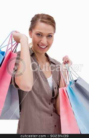 Woman with shopping bags stock photo, Woman with shopping bags against a white background by Wavebreak Media