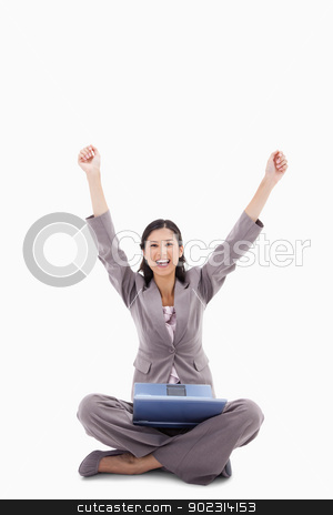 Happy woman with raised arms and laptop stock photo, Happy woman with raised arms and laptop against a white background by Wavebreak Media