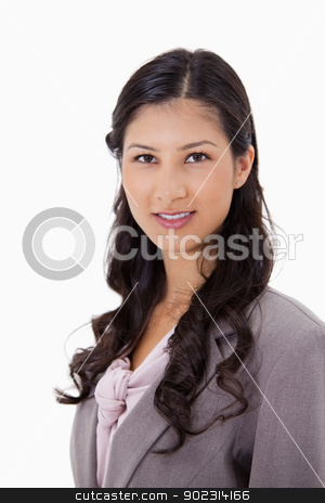 Smiling businesswoman stock photo, Smiling businesswoman against a white background by Wavebreak Media
