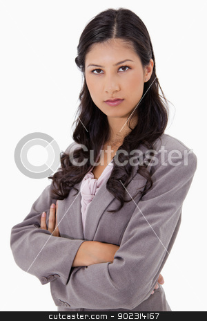 Serious businesswoman with arms folded stock photo, Serious businesswoman with arms folded against a white background by Wavebreak Media