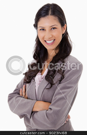 Smiling businesswoman with arms folded stock photo, Smiling businesswoman with arms folded against a white background by Wavebreak Media