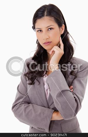 Thinking businesswoman stock photo, Thinking businesswoman against a white background by Wavebreak Media