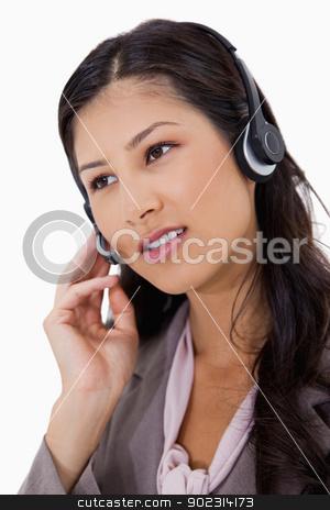 Businesswoman using headset stock photo, Businesswoman using headset against a white background by Wavebreak Media