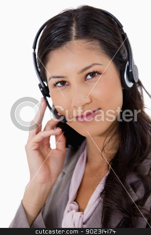 Confident looking businesswoman with headset on stock photo, Confident looking businesswoman with headset on against a white background by Wavebreak Media