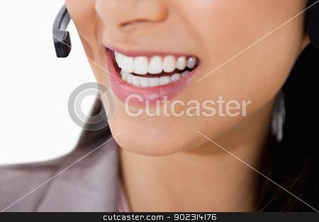 Smile of female call center agent stock photo, Smile of female call center agent against a white background by Wavebreak Media