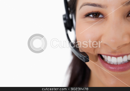 Smiling female call center agent with headset stock photo, Smiling female call center agent with headset against a white background by Wavebreak Media