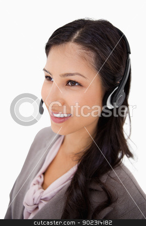 Smiling female call center agent at work stock photo, Smiling female call center agent at work against a white background by Wavebreak Media