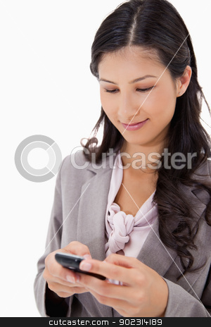 Woman reading text message stock photo, Woman reading text message against a white background by Wavebreak Media