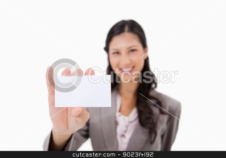 Businesswoman with blank business card stock photo, Businesswoman with blank business card against a white background by Wavebreak Media