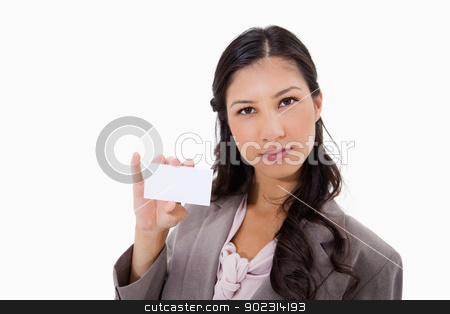 Businesswoman with her blank business card stock photo, Businesswoman with her blank business card against a white background by Wavebreak Media