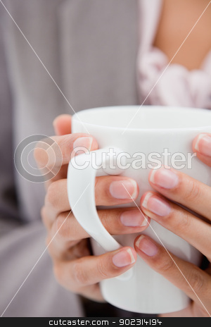 Cup being held by female hands stock photo, White cup being held by female hands by Wavebreak Media