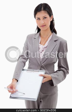 Businesswoman asking for signature stock photo, Businesswoman asking for signature against a white background by Wavebreak Media