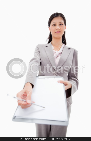 Confident businesswoman asking for signature stock photo, Confident businesswoman asking for signature against a white background by Wavebreak Media