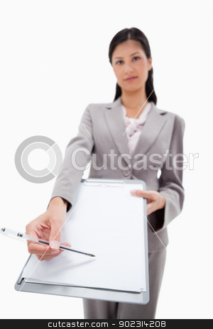 Clipboard and pen being handed over by businesswoman stock photo, Clipboard and pen being handed over by businesswoman against a white background by Wavebreak Media
