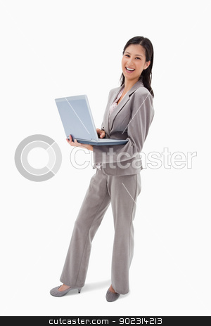 Side view of laughing businesswoman with notebook stock photo, Side view of laughing businesswoman with notebook against a white background by Wavebreak Media
