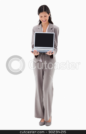 Businesswoman presenting notebook stock photo, Businesswoman presenting notebook against a white background by Wavebreak Media
