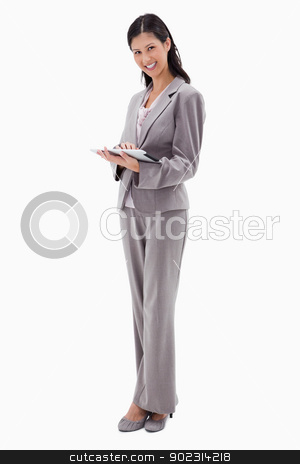 Smiling businesswoman with tablet stock photo, Smiling businesswoman with tablet against a white background by Wavebreak Media
