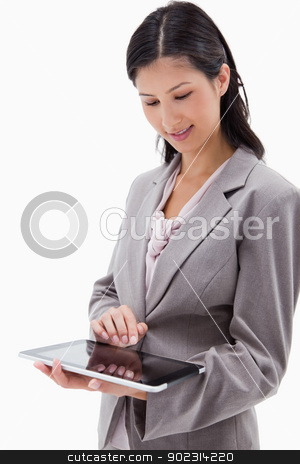 Businesswoman using tablet stock photo, Businesswoman using tablet against a white background by Wavebreak Media
