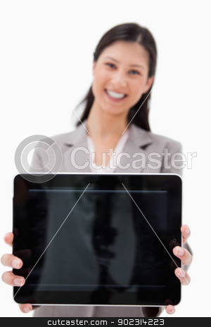 Smiling businesswoman presenting tablet screen stock photo, Smiling businesswoman presenting tablet screen against a white background by Wavebreak Media
