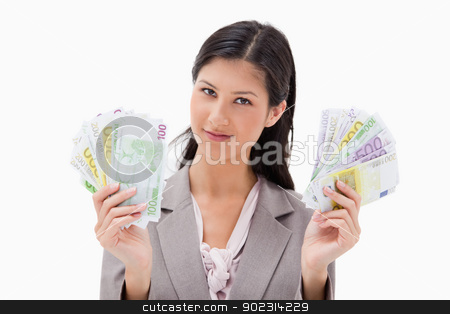 Businesswoman holding money in her hands stock photo, Businesswoman holding money in her hands against a white background by Wavebreak Media