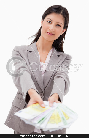 Businesswoman offering money stock photo, Businesswoman offering money against a white background by Wavebreak Media