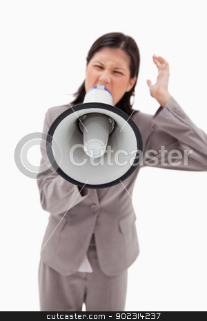 Angry businesswoman shouting through businesswoman stock photo, Angry businesswoman shouting through businesswoman against a white background by Wavebreak Media