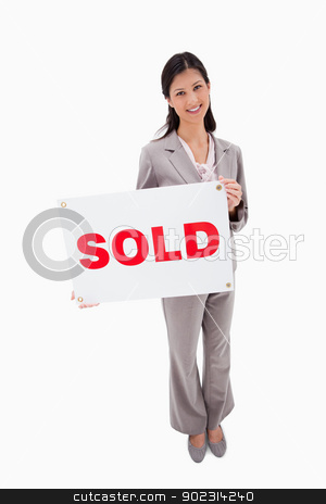 Real estate agent with sold sign stock photo, Real estate agent with sold sign against a white background by Wavebreak Media