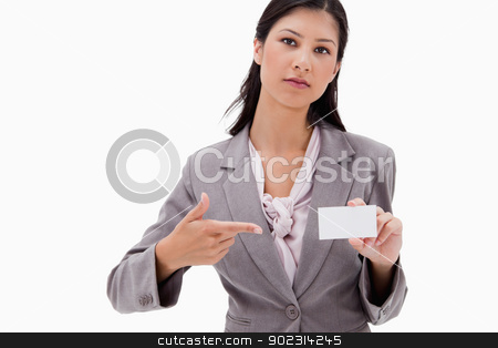 Businesswoman pointing at name badge stock photo, Businesswoman pointing at name badge against a white background by Wavebreak Media