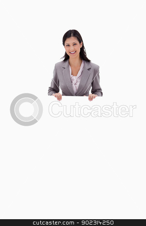 Businesswoman holding blank sign board stock photo, Businesswoman holding blank sign board against a white background by Wavebreak Media