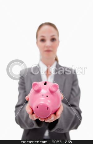 Piggy bank being held by bank employee stock photo, Piggy bank being held by bank employee against a white background by Wavebreak Media