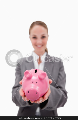 Piggy bank being held by smiling bank employee stock photo, Piggy bank being held by smiling bank employee against a white background by Wavebreak Media