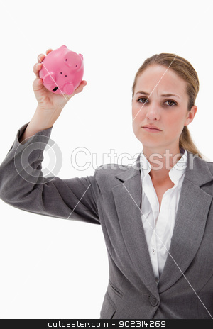 Sad bank employee with empty piggy bank stock photo, Sad bank employee with empty piggy bank against a white background by Wavebreak Media