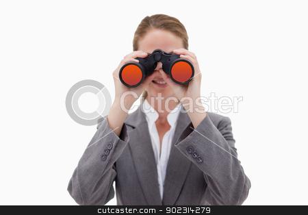 Bank employee using spy glasses stock photo, Bank employee using spy glasses against a white background by Wavebreak Media