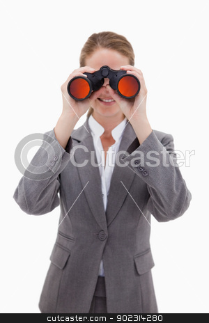 Bank employee looking through spyglasses stock photo, Bank employee looking through spyglasses against a white background by Wavebreak Media
