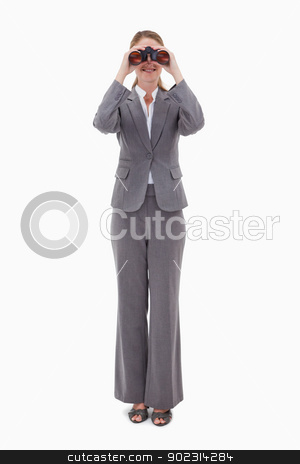 Bank employee using binoculars stock photo, Bank employee using binoculars against a white background by Wavebreak Media