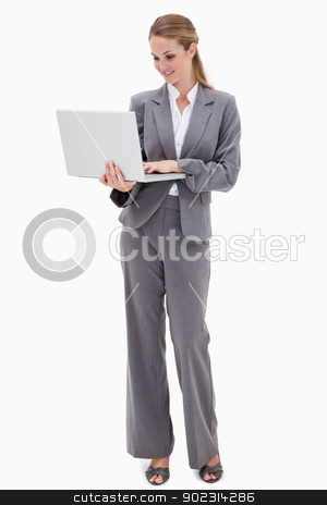 Bank employee with laptop stock photo, Bank employee with laptop against a white background by Wavebreak Media