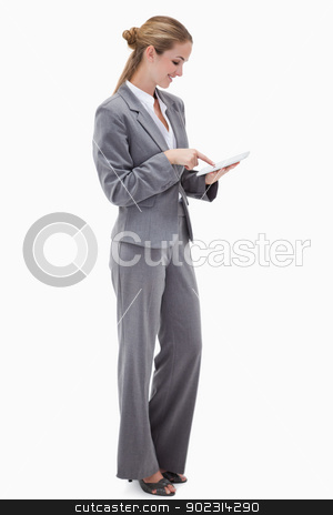 Side view of bank employee using tablet stock photo, Side view of bank employee using tablet against a white background by Wavebreak Media