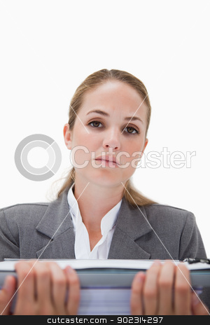 Frustrated office employee with pile of paperwork stock photo, Frustrated office employee with pile of paperwork against a white background by Wavebreak Media