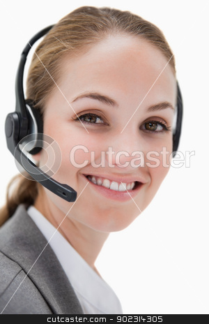 Smiling female call center agent working stock photo, Smiling female call center agent working against a white background by Wavebreak Media