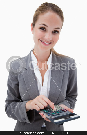 Smiling bank employee with pocket calculator stock photo, Smiling bank employee with pocket calculator against a white background by Wavebreak Media