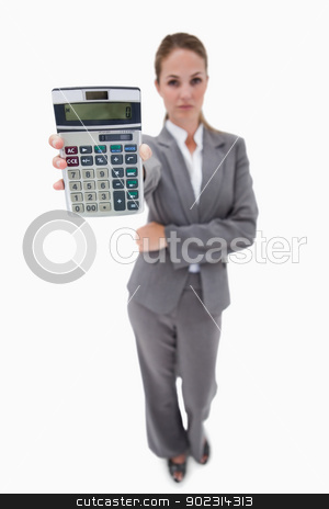 Bank employee showing her hand calculator stock photo, Bank employee showing her hand calculator against a white background by Wavebreak Media