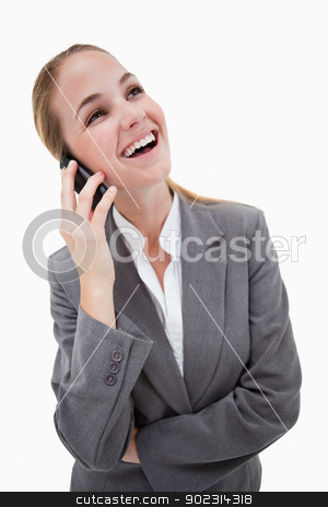 Laughing bank employee on her cellphone stock photo, Laughing bank employee on her cellphone against a white background by Wavebreak Media