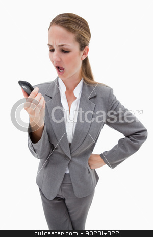 Indignant looking bank employee reading text message stock photo, Indignant looking bank employee reading text message against a white background by Wavebreak Media