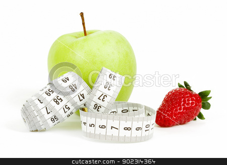 Measuring tape wrapped around a green apple and strawberry as a symbol of diet stock photo, Measuring tape wrapped around a green apple and strawberry as a symbol of diet concept by Artush