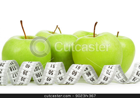Measuring tape around a green apples as a symbol of diet. stock photo, Measuring tape around a green apples as a symbol of diet on white background by Artush