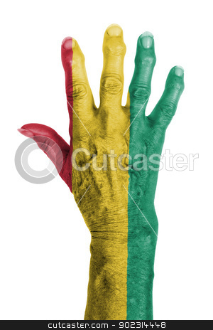 Hand of an old woman wrapped in flag stock photo, Hand of an old woman wrapped in flag of Guinea by michaklootwijk