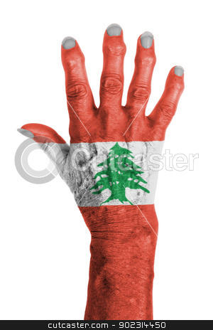 Hand of an old woman wrapped in flag stock photo, Hand of an old woman wrapped in flag of Lebanon by michaklootwijk