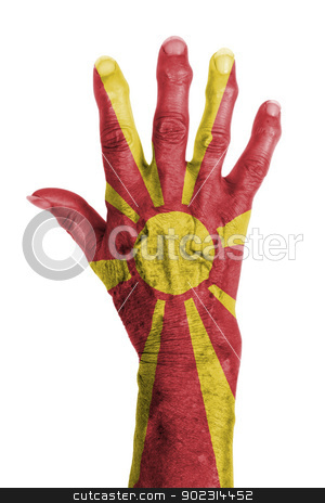 Hand of an old woman wrapped in flag stock photo, Hand of an old woman wrapped in flag of Macedonia by michaklootwijk