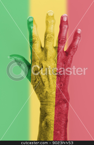 Hand of an old woman wrapped in flag stock photo, Hand of an old woman wrapped in flag of Mali by michaklootwijk