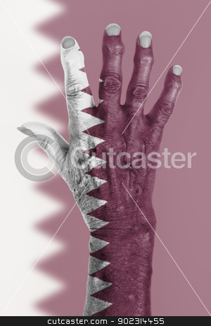 Hand of an old woman wrapped in flag stock photo, Hand of an old woman wrapped in flag of Qatar by michaklootwijk